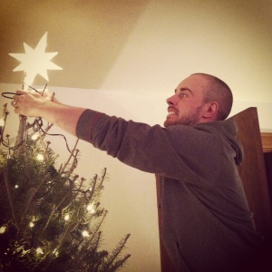 Dan putting the star on our tre